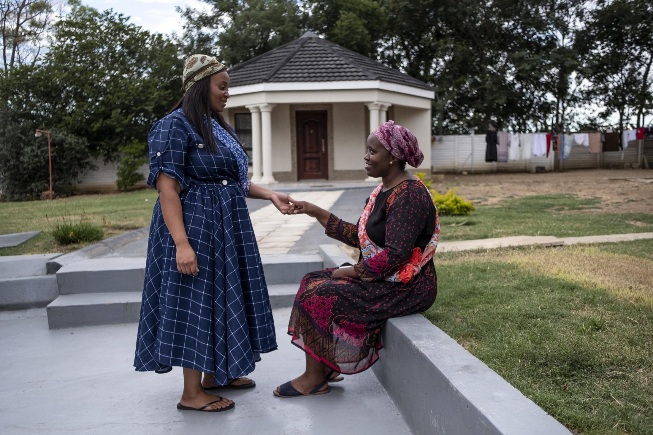 18 February 2020: Women of the Shabalala household chat to each other outside the home after the memorial service for Ladysmith Black Mambazo founder Joseph Shabalala in Ladysmith Kwa-Zulu Natal.
