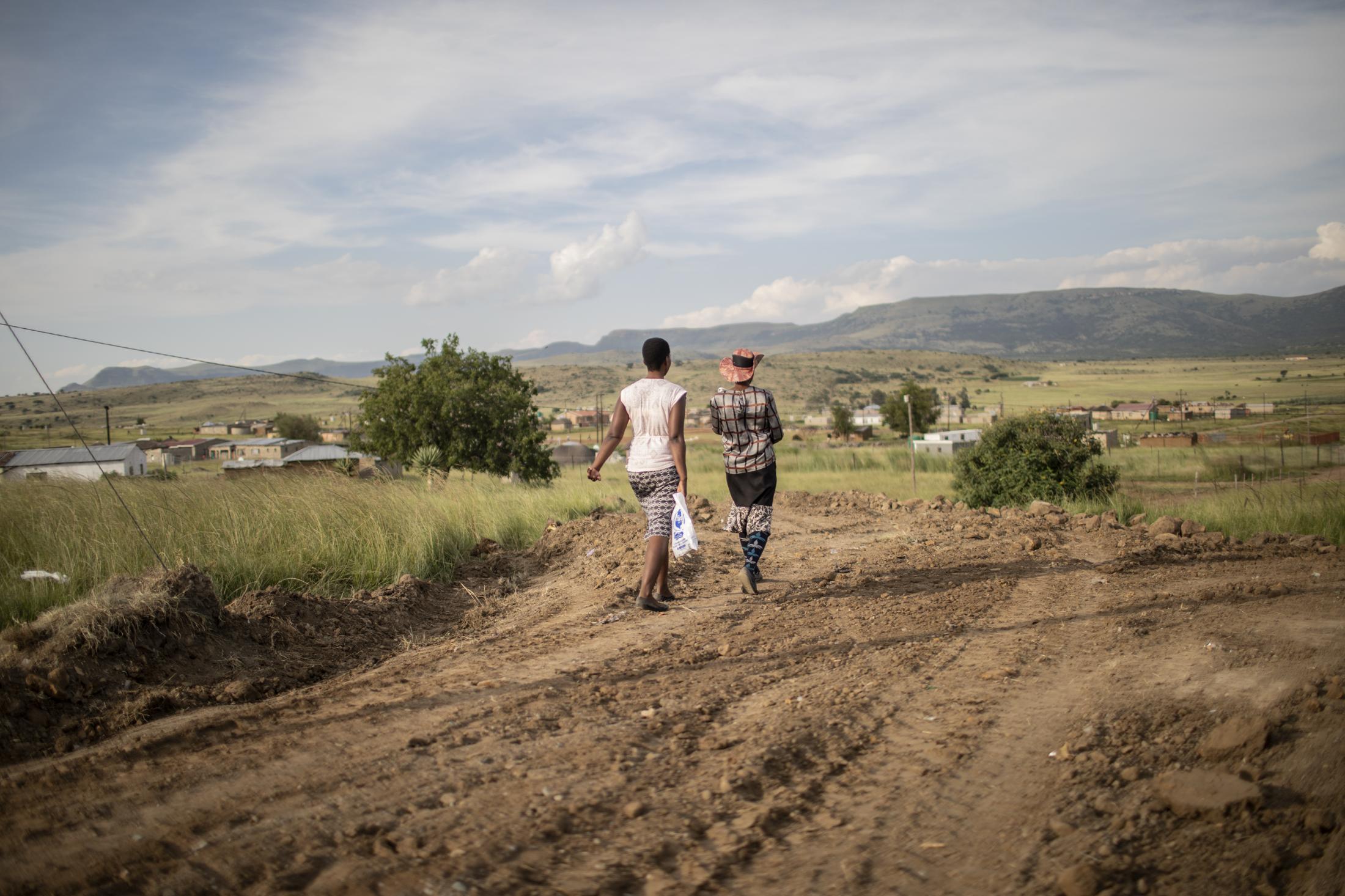 17 February 2020: Women walk on the roads close to the Vilakazi home in Watersmeet, Ladysmith, Kwa-Zulu Natal.