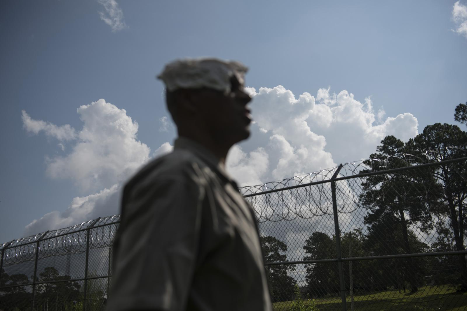John Bonner, looks out over barbed wire fencing at what was once the White House, where he was brutally beaten while sentenced at Dozier. The institution opened in 1901 and was shut down in 2011 amid repeated scandals and reports of severe brutality and slave labor. Thousands of boys, most of them black, living in segregated conditions until 1968, passed through Dozier.. This year, graves on the site were being exhumed to determine whether several boys who had disappeared, were buried on the site. Survivors of the camp, including five black men, revisited the grounds and for the first time publicly told their stories.