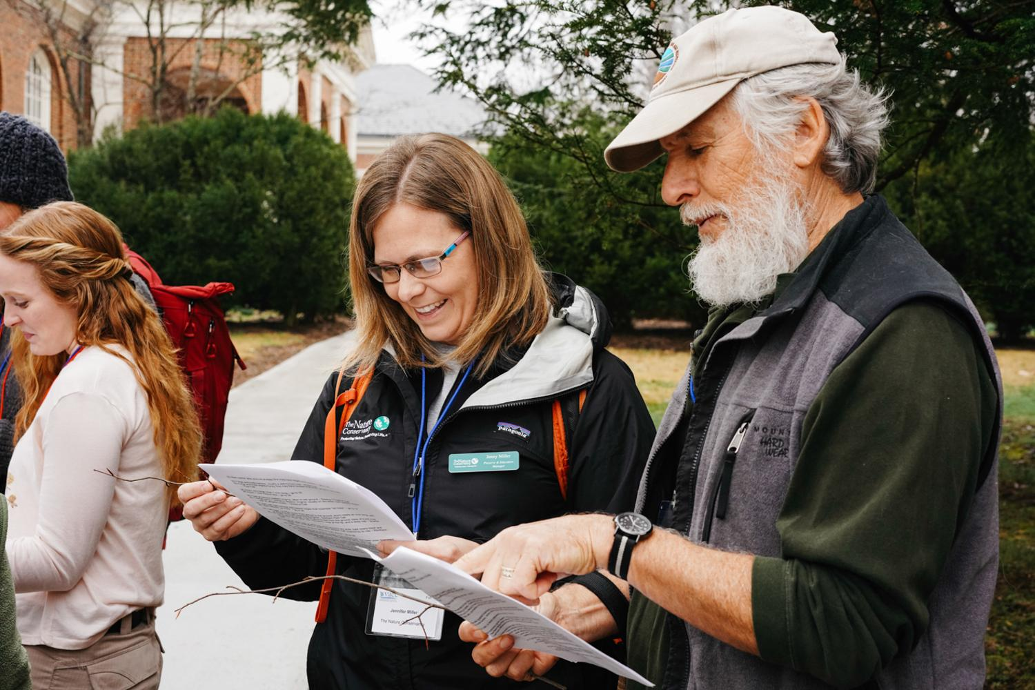 Two wildlife and environmental enthusiasts and members of the VAEE read from an information packet provided by the organization, 2020.