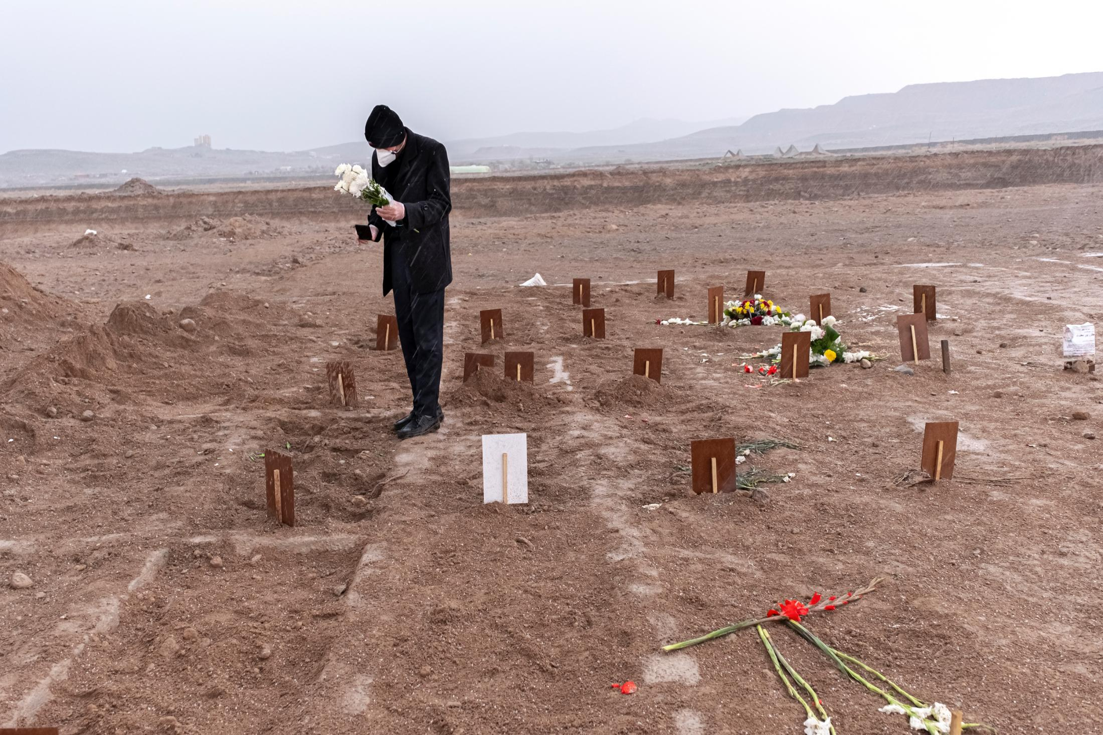 Rasool Zohuri Kahanmooei, the son of the victim of the Corona virus, takes live pictures from his father's grave a few moments after his burial. He, using a cell phone, informs his family members of his father's burial that they could not attend the funeral. The victim's family cries and screams are heard from behind the cell phone. Before the outbreak of the coronavirus, many family members and acquaintances attended the funeral, but given the new circumstances, Rasul is now alone. His father died four days after being discharged from the hospital. Rasool himself, who lived with his father, became infected with the coronavirus and is now in a state of self-quarantined and no one visits him.
