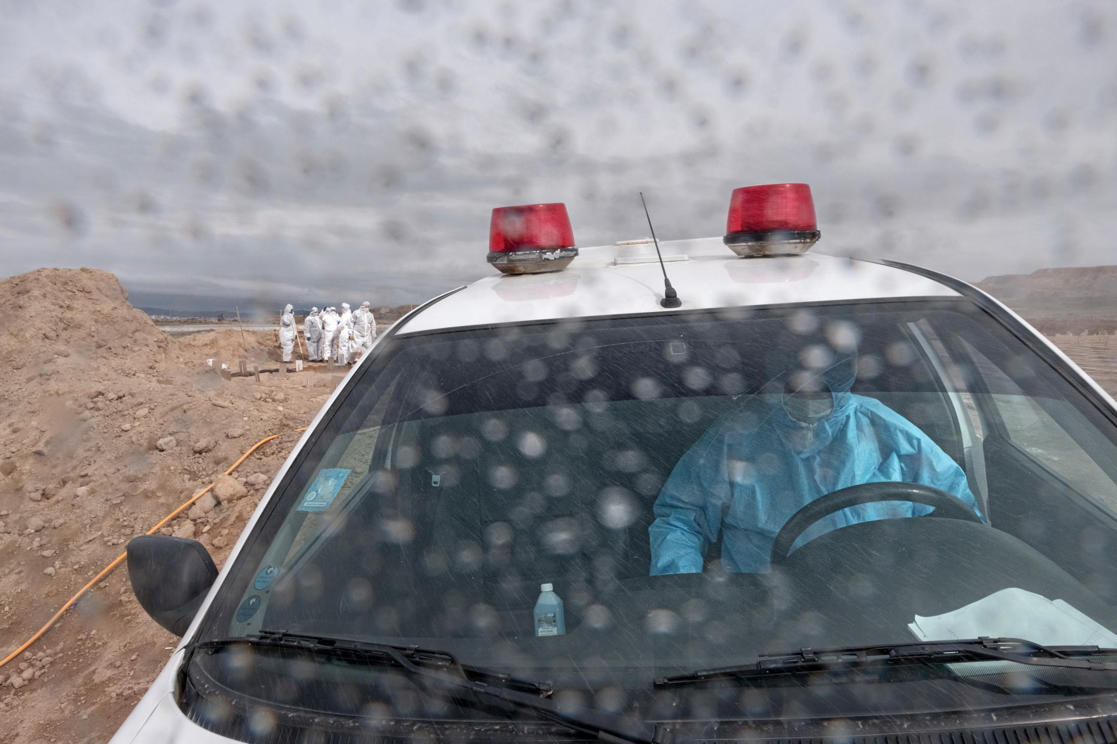 Mr.Anonymous ambulance driver was carrying a victim body to the burial site, where I accompanied him. He said he was unhappy with his job, worried about transmitting the virus to himself or his family, and his workplace was stressful, too. He says the outbreak of the coronavirus has made the situation more difficult and the repair shops do not accept ambulance repairment.