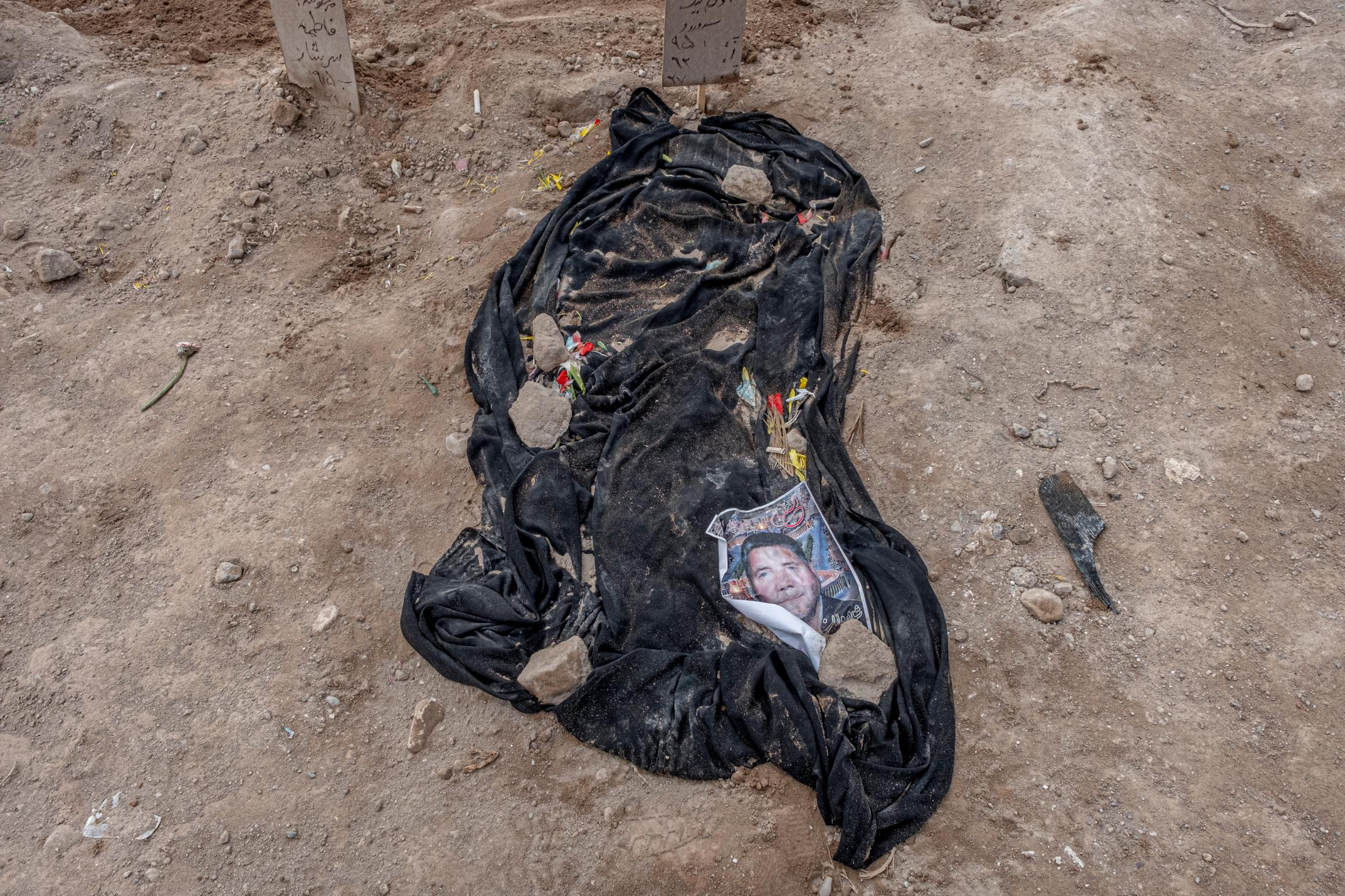 According to the cultural and religious rites of Azerbaijan, a black cloth is spread on the grave of the deceased as a sign of mourn. The installation of the tombstone takes several days due to the sensitivity and prevalence of the coronavirus.