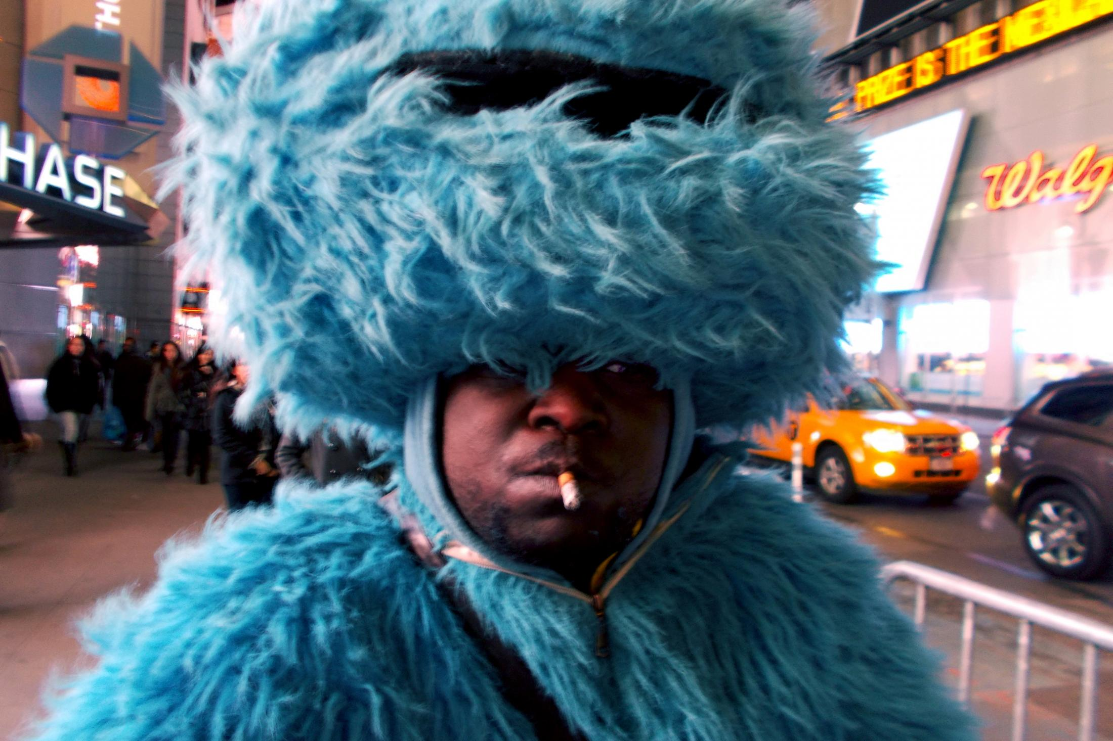 New York, UNITED STATES ,Immigrant dressed up as Cookie Monster ask for donations after posing for pictures in Times Square. 2013 Joana Toro.