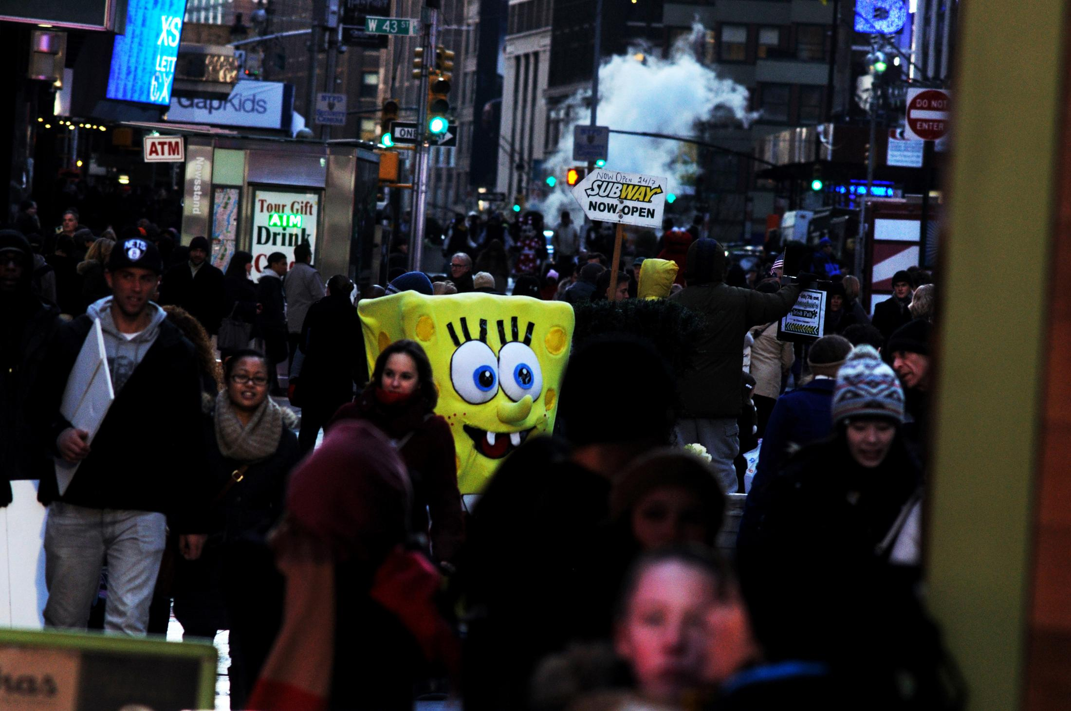 New York, UNITED STATES ,Immigrant dressed up as Bob Sponge ask for donations after posing for pictures in Times Square. 2013 Joana Toro.