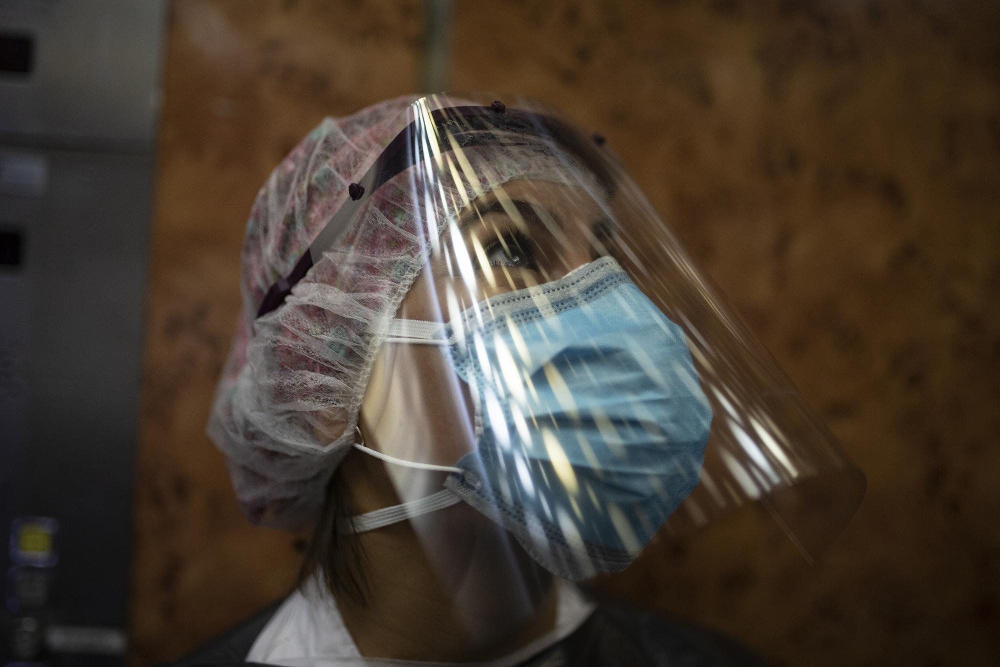 Nurse Melba Vasquez dressed in protective gear takes an elevator in a nursing home to perform covid-19 tests on residents with symptoms of the new coronavirus. Barcelona April 14, 2020
