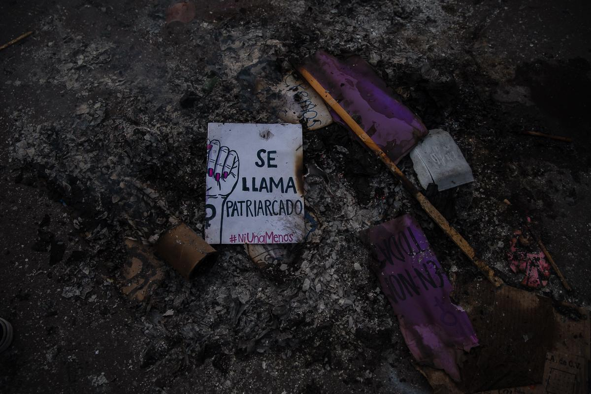 "Part of a sign reading ""It's called patriarchy"" is seen in a burnt pile in Zocalo square during International Women's Day protest in Mexico City, Mexico March 8, 2020."