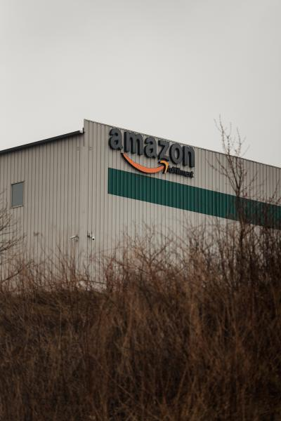 An Amazon fulfillment center sits on top of a hill in the Humboldt Industrial Park in Hazleton, PA. on Saturday, April 18, 2020. Amazon is considered an essential business and is still open. Hazleton has been hit the hardest with the coronavirus in Pennsylvania. Hannah Yoon