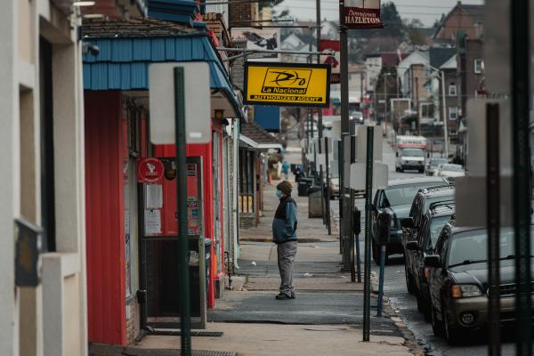A man waits in line outside of a tax office in Hazleton, PA. on Saturday, April 18, 2020. Hazleton has been hit the hardest with the coronavirus in Pennsylvania. Hannah Yoon