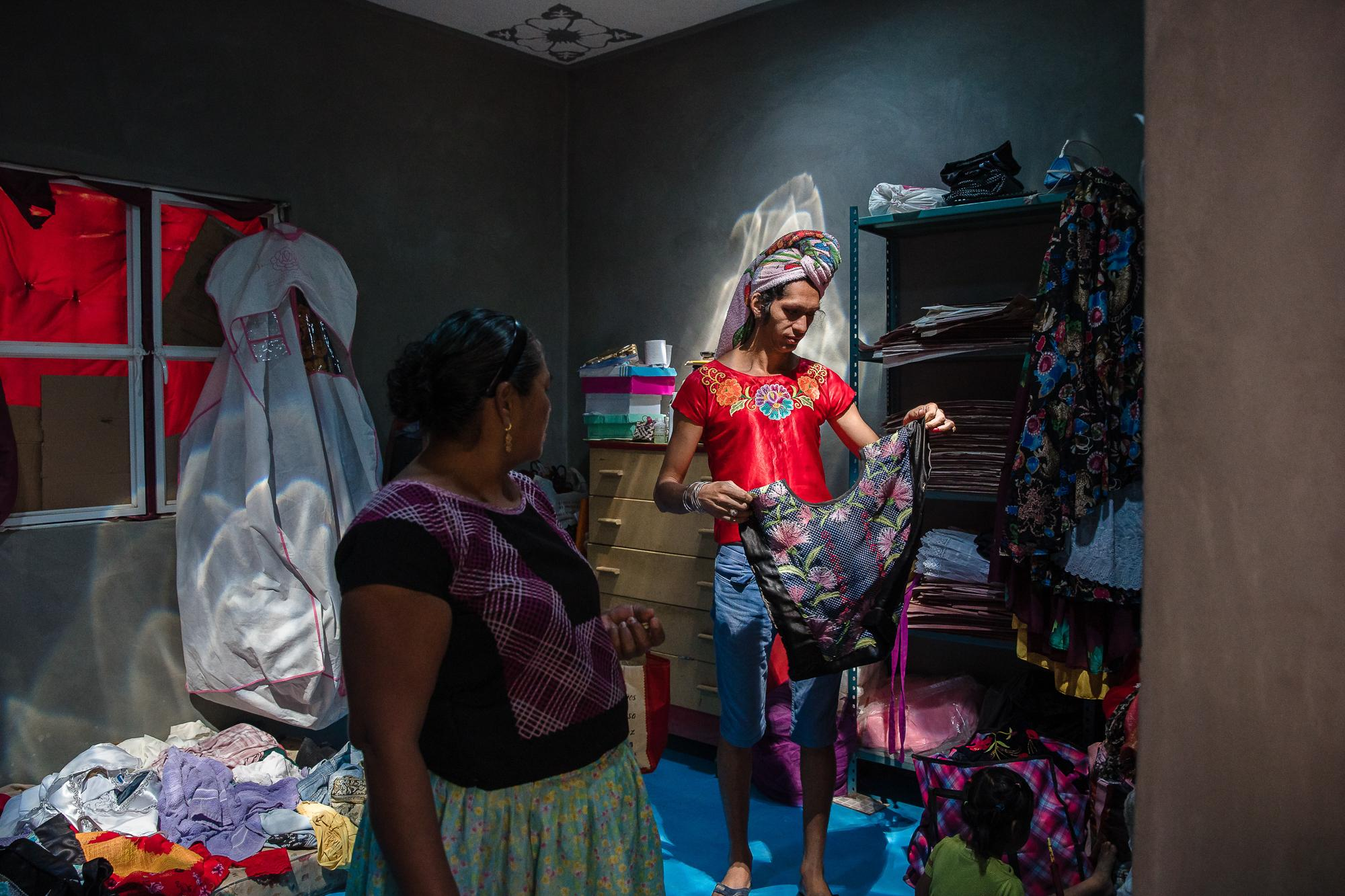 Estrella Vasquez a weaver and designer is the first transgender muxe woman to appear on the cover of Vogue in December of 2019, looks for an outfit while her mother checks in on her in their home in Juchitán de Zaragoza an indigenous town in the southeast of the Mexican state of Oaxaca.