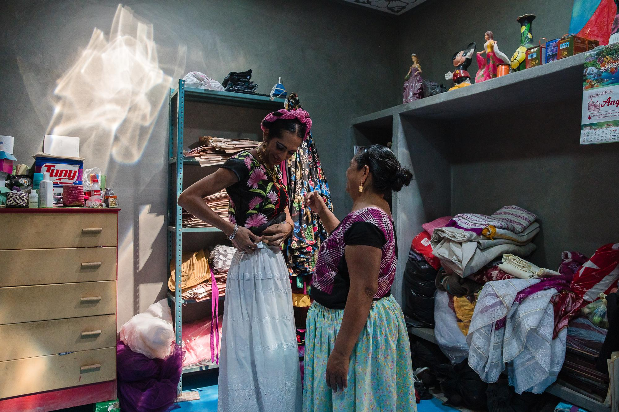 Estrella's mom helps her get ready.  Estrella was born a man but prefers to be identified as a woman.