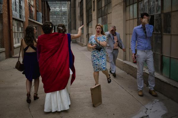 Wedding attendees react to seeing the bride before the ceremony at the Rail Yards in Albuquerque, New Mexico.