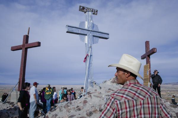 Roberto Doming stands at the top of Tomè Hill where thousands of pilgrims hike to observe Good Friday in Tomè, New Mexico.
