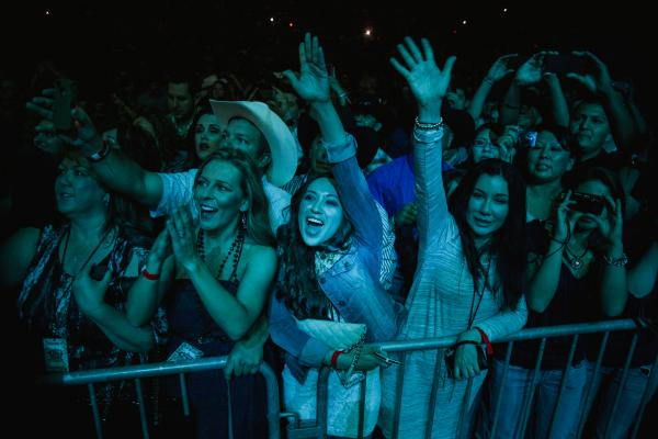 Fans cheer for George Strait at a concert in Albuquerque, NM on April 5, 2013.