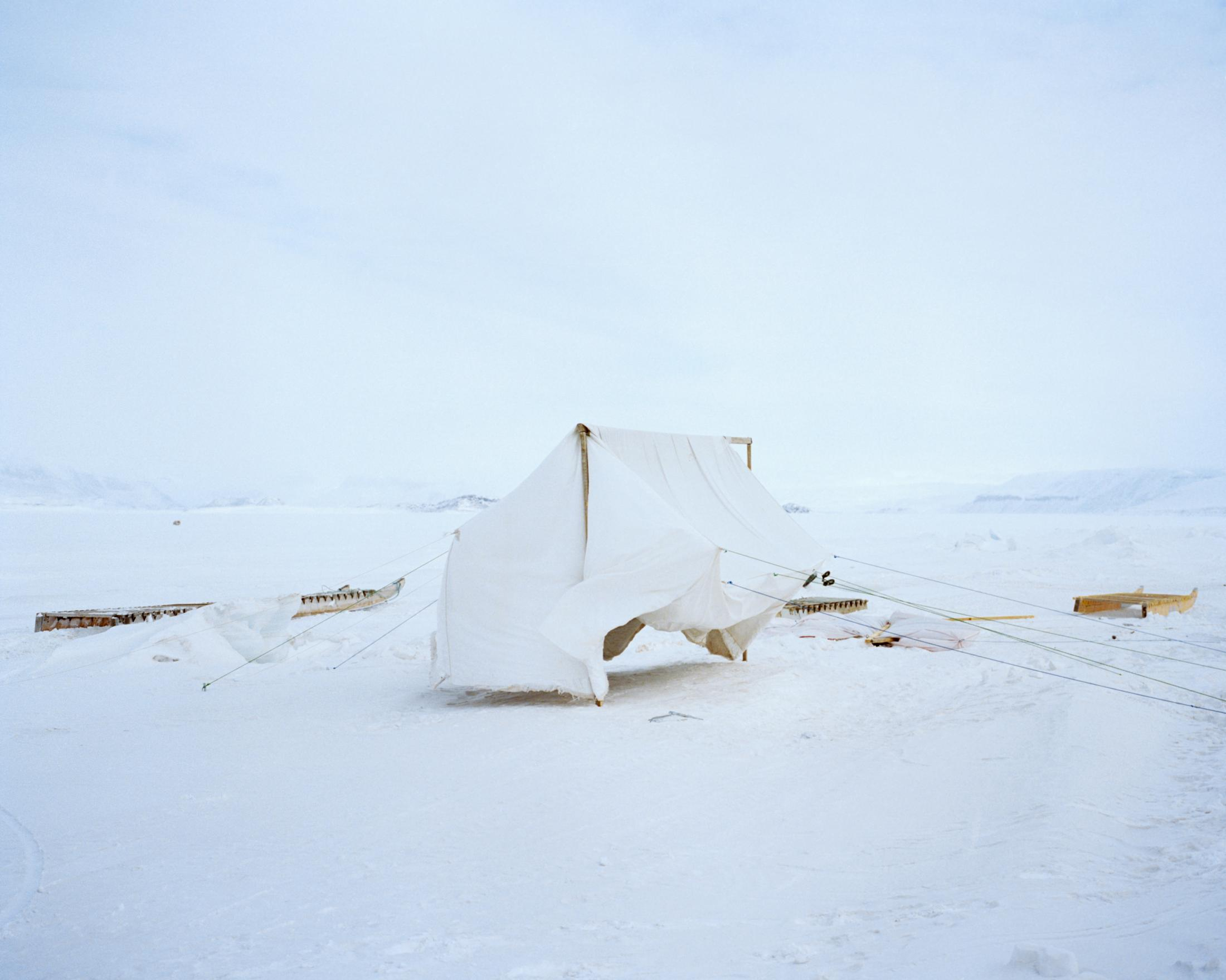 Before a camping trip, a homemade tent dries on the sea ice in Nunavut.