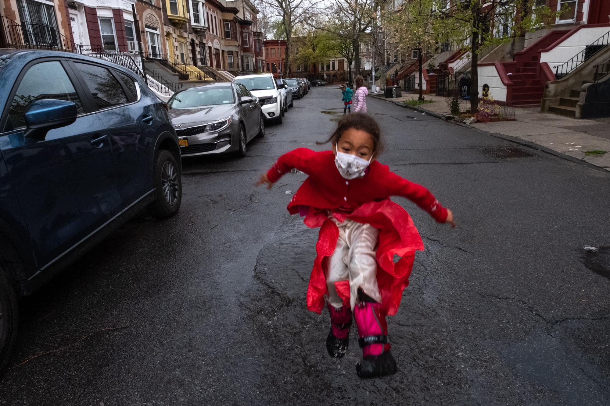 April 24, 2020: Today Amal turned 6. Four families on the block come out with signs for a socially distanced rendition of happy birthday. Afterwards the kids gleefully jump in puddles. I've lost track of how long it's been since we went out front. Needless to say it is the highlight of our lockdown. So much has changed since the beginning of the pandemic. Most of us have lost people we love and the kids no longer need reminding to stay far apart.