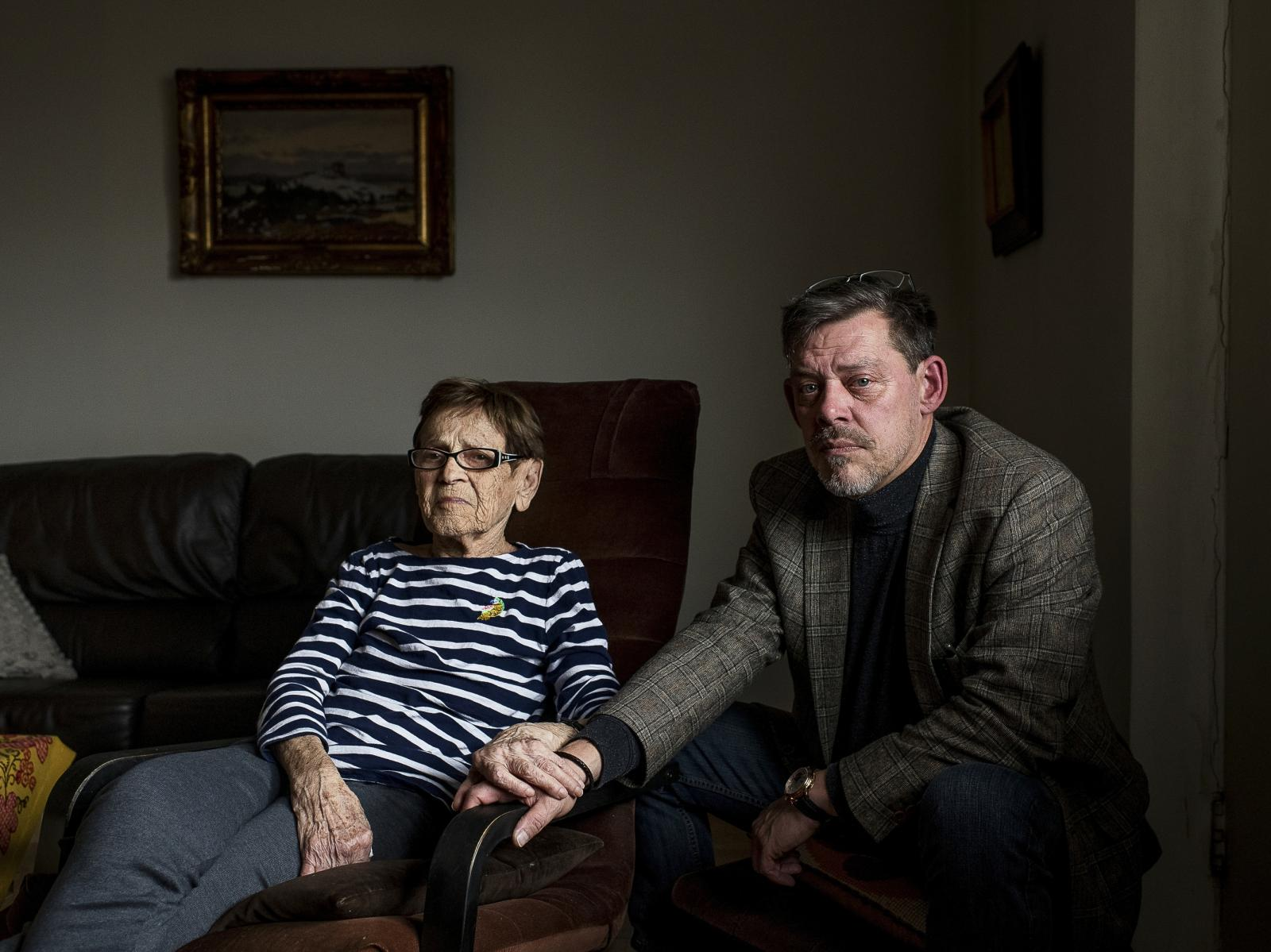 Rainer Hoess, the grandson of the Auschwitz commandaner Rudolf Hoess, poses for a portrait with Auschwitz survivor Edith Grosman, 95, at her home in Toronto on November 3, 2019. Hoess has dedicating himself to talking about his family's past, and supporting holocaust survivors in an attempt to combat hate and rising extremism. /Aaron Vincent Elkaim for The Globe and Mail