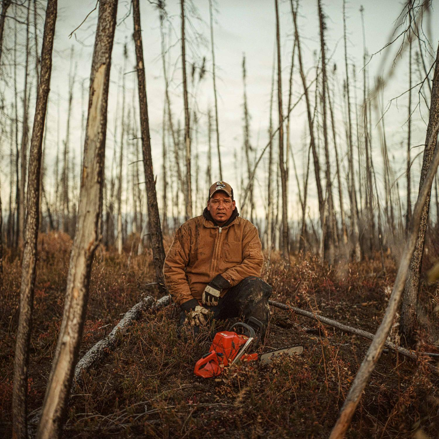 September 26, 2018. Robert Spence rests while cutting firewood near his trapline on the Churchill River, where he takes his family to hunt moose each fall in Northern Manitoba Canada. Spence is an elected Councillor the Tataskweyak Cree Nation known as the community of Split Lake, he once provided for his family as a commercial fisherman and fur trapper, but left the profession after the fishery became unprofitable due to declining stock and quality due to the impact of hydro dams on the river. Spence has long been a critic of Manitoba Hydro and decries their impact to his traditional land and waters, and as a Councillor works closely with them in an effort to mitigate further impacts to the land, river and community.