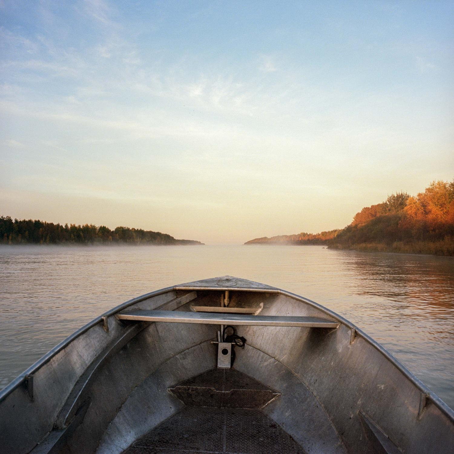 September 23 2016. A fisherman's boat approaches Two Mile Channel, an artificial channel created by Manitoba Hydro between Playgreen Lake, upstream from the community of Norway House Cree Nation, and Lake Winnipeg as part of the Lake Winnipeg Regulation. Historical construction activities in the 1970's resulted in soil and groundwater contamination along with the continued presence of construction debris along it's banks. Significant erosion continues around the channel to this day, resulting in the sedimentation of Playgreen Lake impacting drinking water, light penetration and oxygen production impacting the ecosystem. https://www.lwic.org/location/2-mile-channel