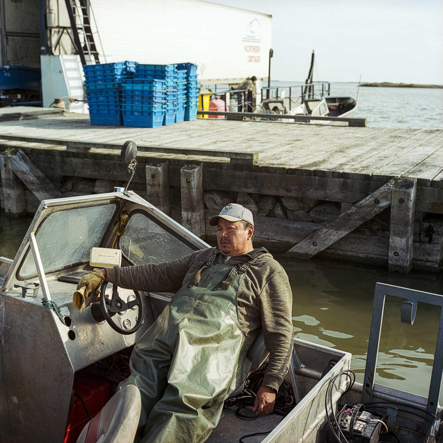 September 2016. Langford Saunders, President of the Norway House Fisherman's Co-op, rests in his boat after a day of commercial fishing on Lake Winnipeg in Northern Manitoba. Many fisherman complain of changes to their waterways due to hydro regulation; from a green slime and debris that gets caught in there nets, to an increase in lower grades of fish, such as mullet, instead of the higher priced pickerel and white fish.
