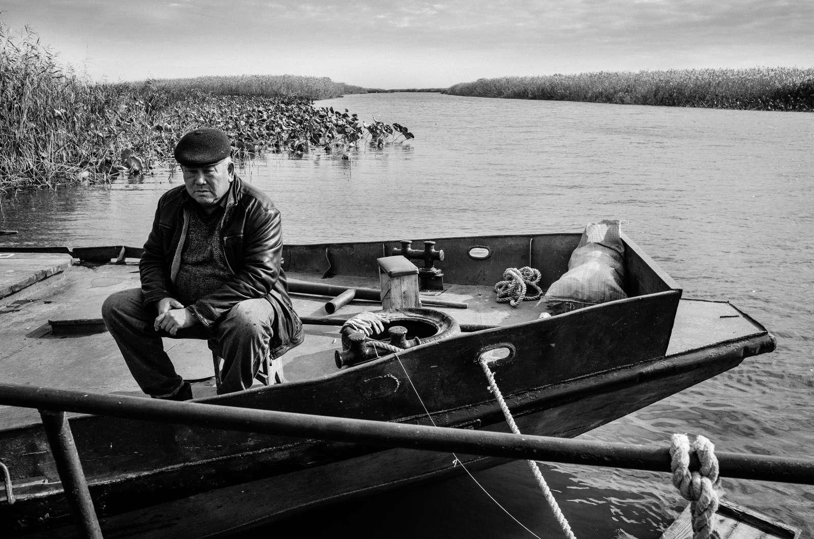 Fatih - The Capitan of a fish ship is waiting for the fishermen to bring fish. October 2016 Kirovsky, Astrakhan Disctrict. Russia. © Stoyan Vassev