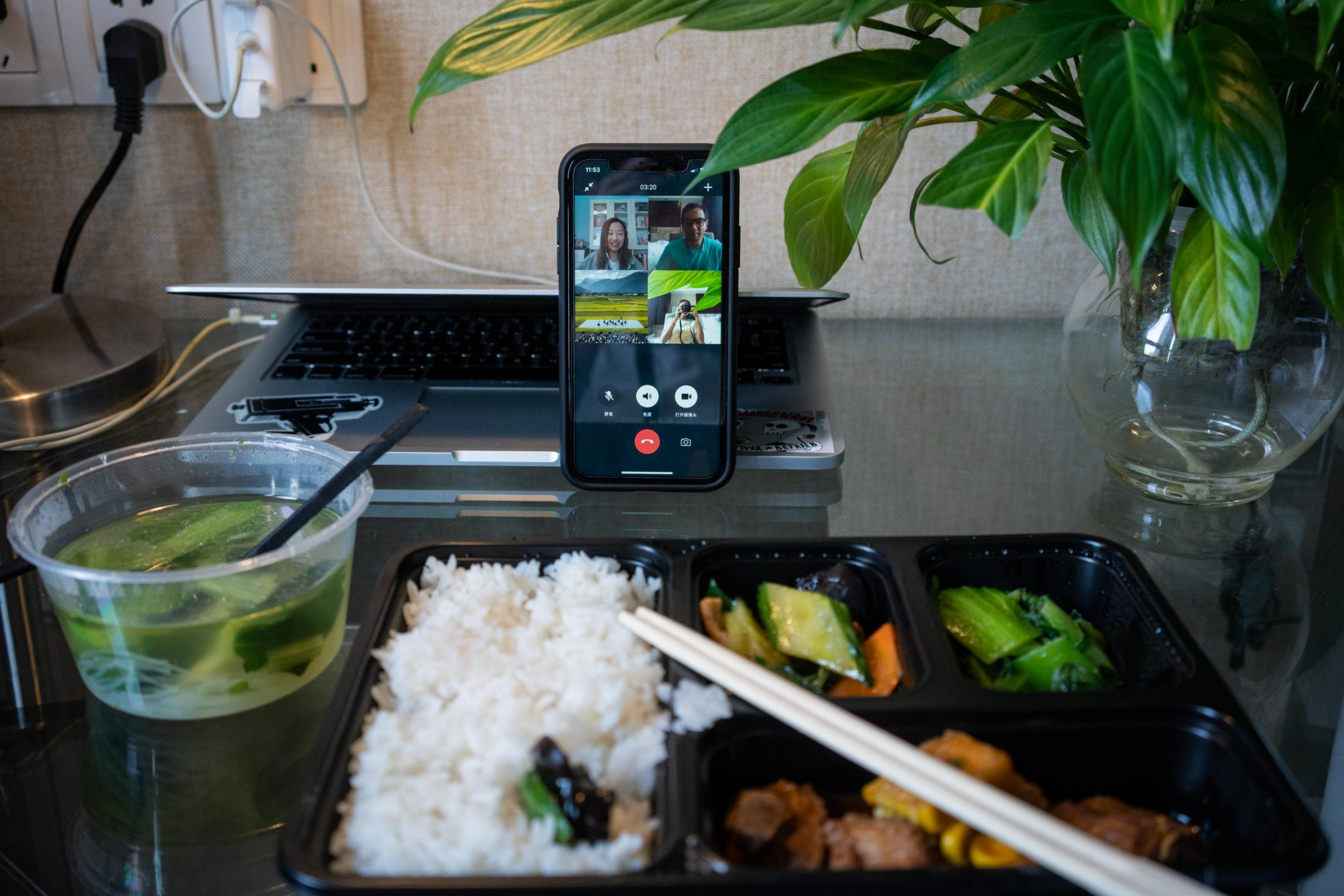 With my lunch box opened in front of the cell phone, we're having a brunch video chat with two other friends in Beijing, on the ninth day of quarantine.