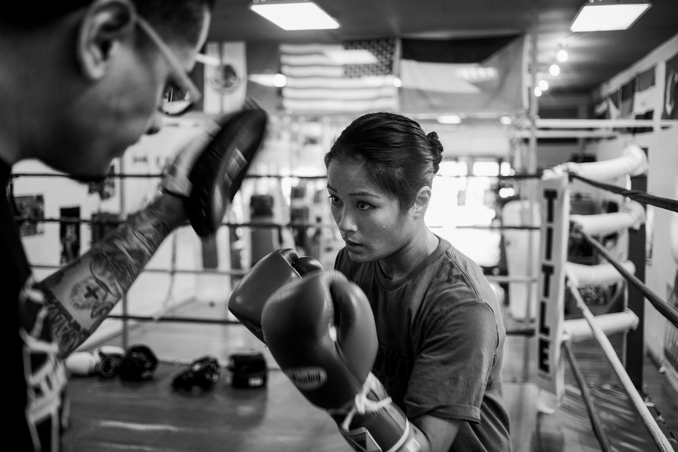 Jairo Escobar, Casey Morton's full-time coach, works with her to improve strategy and learn new boxing techniques at World Class Boxing Gym in San Francisco, CA.