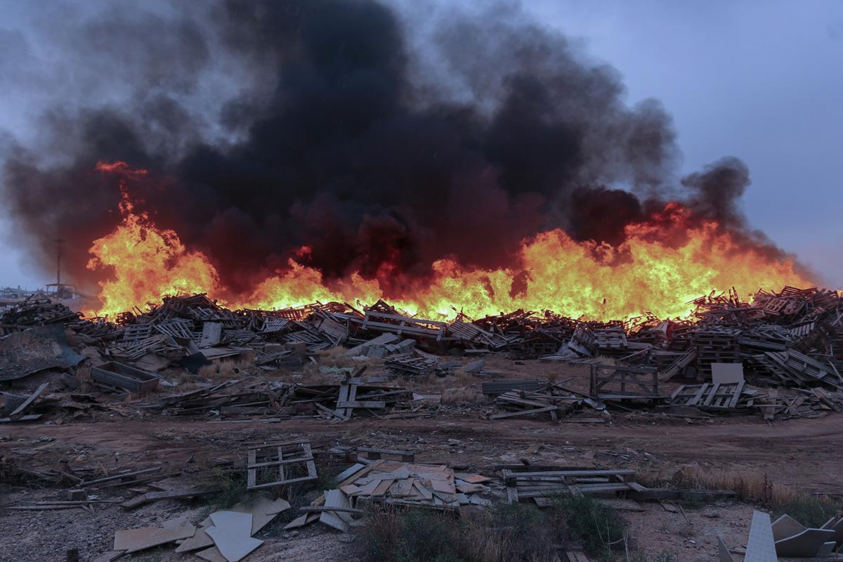 AlborzIndustrial City –Qazvin Province -Iran Wooden panels, which are located around the workshops of the industrial city of Alborz, have been burnt.