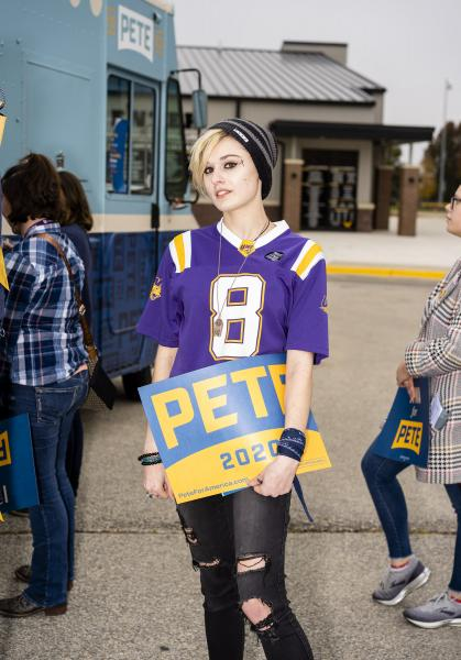 Leah Roughton of Manchester, Iowa poses for a photograph while waiting in line to buy merchandise for South Bend, Indiana mayor and 2020 presidential candidate Pete Buttigieg after he spoke to Iowans at a town hall in Waverly, Iowa on Sunday, November 3, 2019. KC McGinnis for Politico Magazine