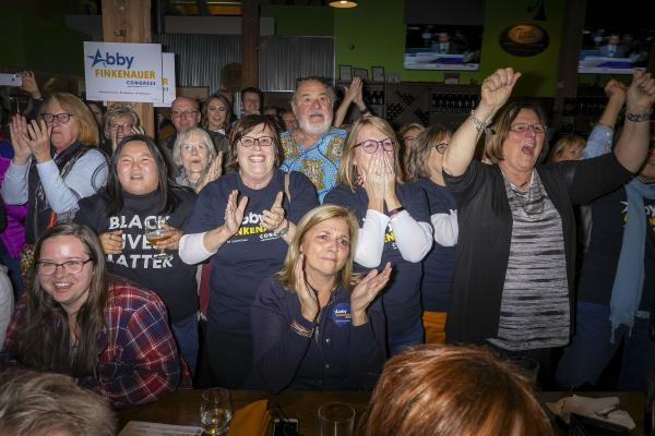 Supporters of Democratic congressional candidate Abby Finkenauer react during her midterm election night party in Dubuque, Iowa, U.S. November 6, 2018. REUTERS/KC McGinnis