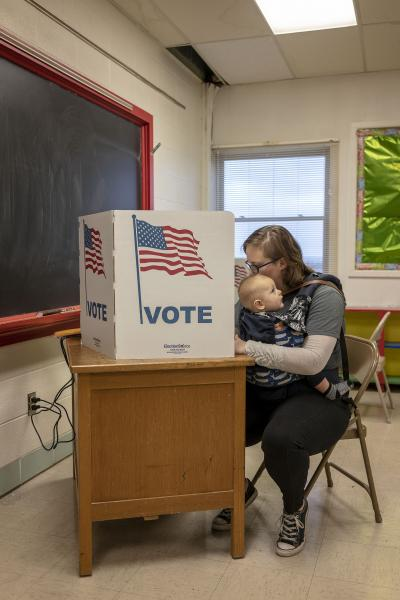 Katie Wilker of Sherrill, Iowa votes with her son Torin Wilker during midterm elections at SS Peter & Paul School in Sherrill, Iowa, U.S. November 6, 2018. REUTERS/KC McGinnis