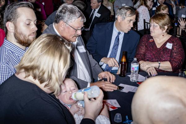 Senator Jeff Merkley speaks with Iowa State Representative Marti Anderson at the Progress Iowa Holiday Party at the Temple for the Performing Arts in Des Moines, Iowa on Thursday, December 20, 2018. KC McGinnis for Buzzfeed