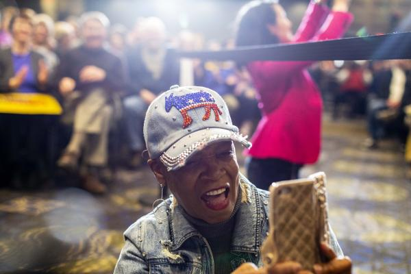 Sheilia Burrage cheers while listening to Senator Kamala Harris (D-CA) campaign at the Quad Cities Waterfront Convention Center in Bettendorf, Iowa on Sunday, February 24, 2019.