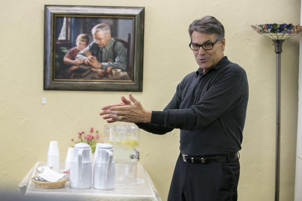 Former Texas governor and 2016 Republican presidential candidate Rick Perry speaks during a campaign event at the Bread Basket Tea Room in Manchester on Sunday, August 9, 2015. (KC McGinnis / The Gazette)