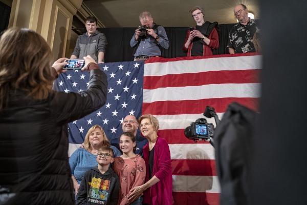 Elizabeth Warren takes a picture with Daniel and Molly Kueffer of Sergeant Bluff, Iowa, along with 11-year-old Abby Kueffer and 10-year-old Baylen Kueffer at an organizing event at the Sioux City Orpheum in in Sioux City, Iowa on Saturday, January 5, 2018. KC McGinnis for Buzzfeed News