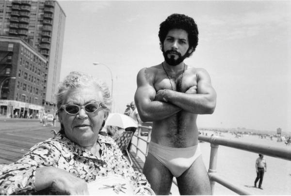 Angel & Woman, On Boardwalk  Brighton Beach, New York 1976  11 inches X 14 inches (279.4mm X 355.6mm) Vintage Silver Gelatin Print   Inquire Here