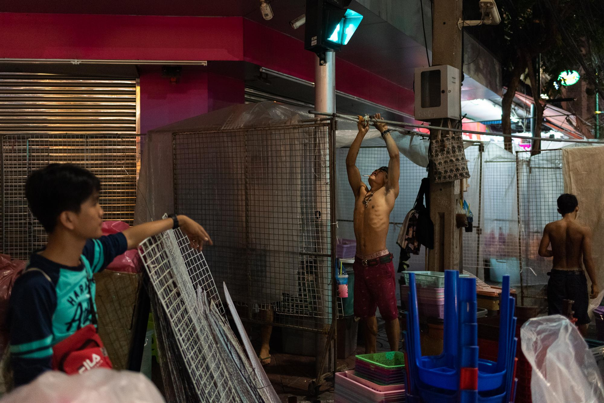 BANGKOK, THAILAND – DECEMBER 11, 2018: Burmese workers at Sampheng Market. Due to limited education background and language barriers, they are hired for low-skilled labor jobs and receive minimum daily wages (10.50 USD/day), which are higher than what they earn in their home country (3.50 USD/day).