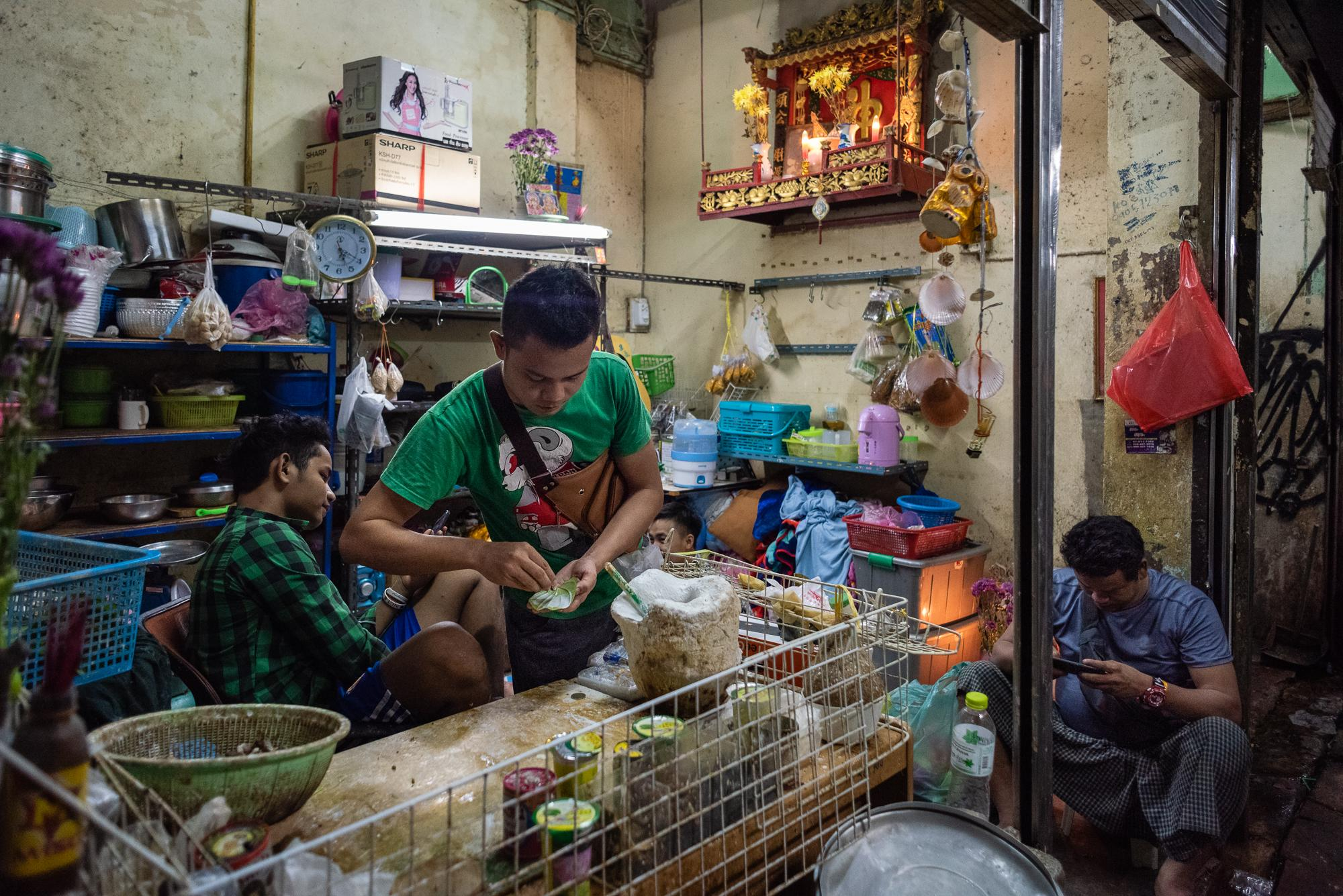 BANGKOK, THAILAND – AUGUST 25, 2018: A betel shop run by a family of Burmese workers in the Old Market. It also serves as the meeting point for Burmese workers in Yaowarat. Many Burmese men still maintain the habit of betel chewing, even when it is no longer common in urban society of Bangkok.