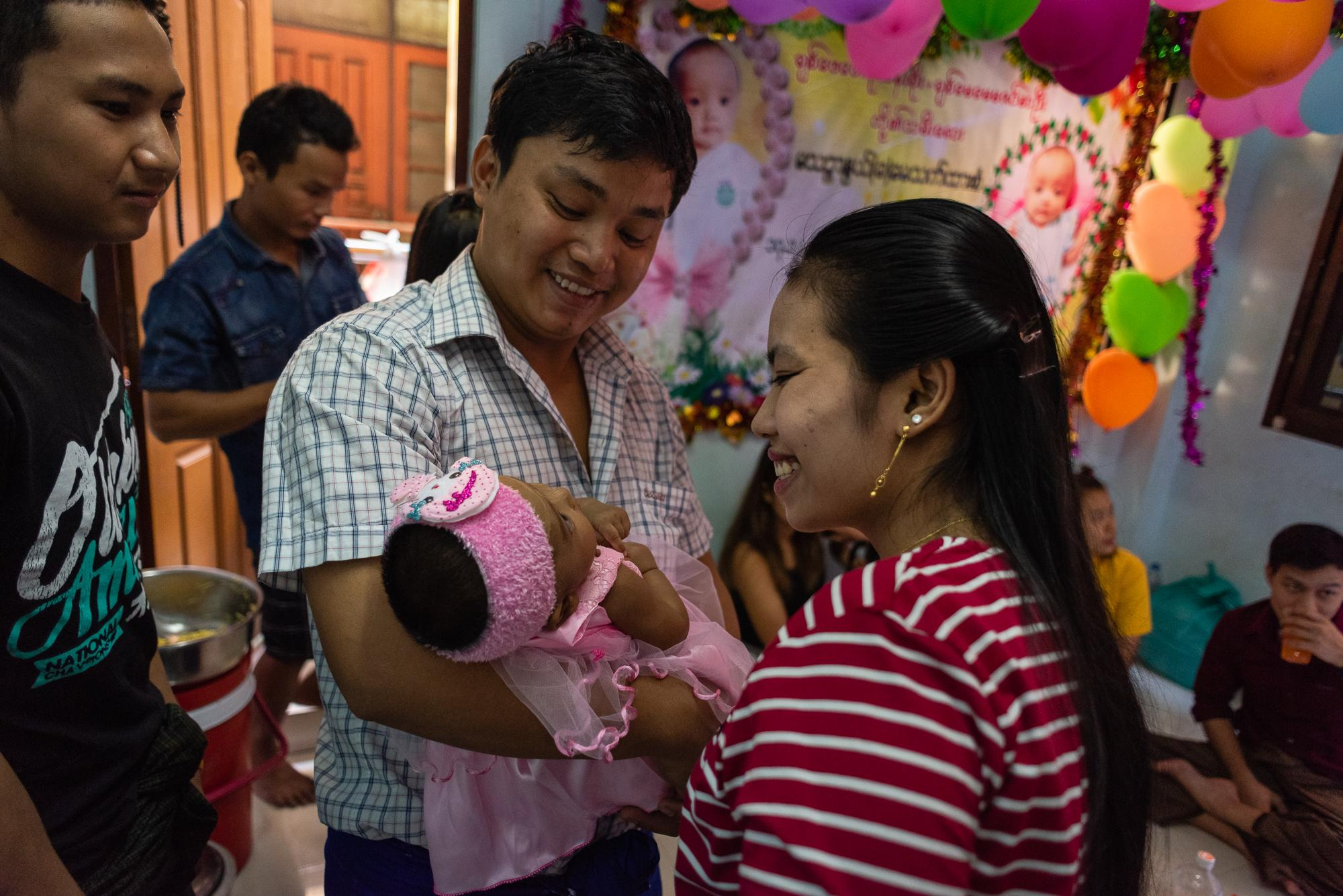 BANGKOK, THAILAND – DECEMBER 17, 2018: At a party to celebrate and welcome a newborn of a Burmese worker family in Yaowarat.