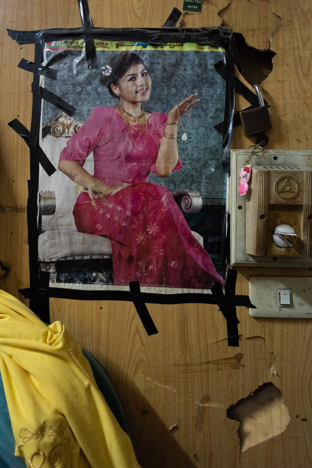 BANGKOK, THAILAND – SEPTEMBER 6, 2018: A poster of a Burmese actress inside a shared apartment of Burmese workers, as a reminder of their home.