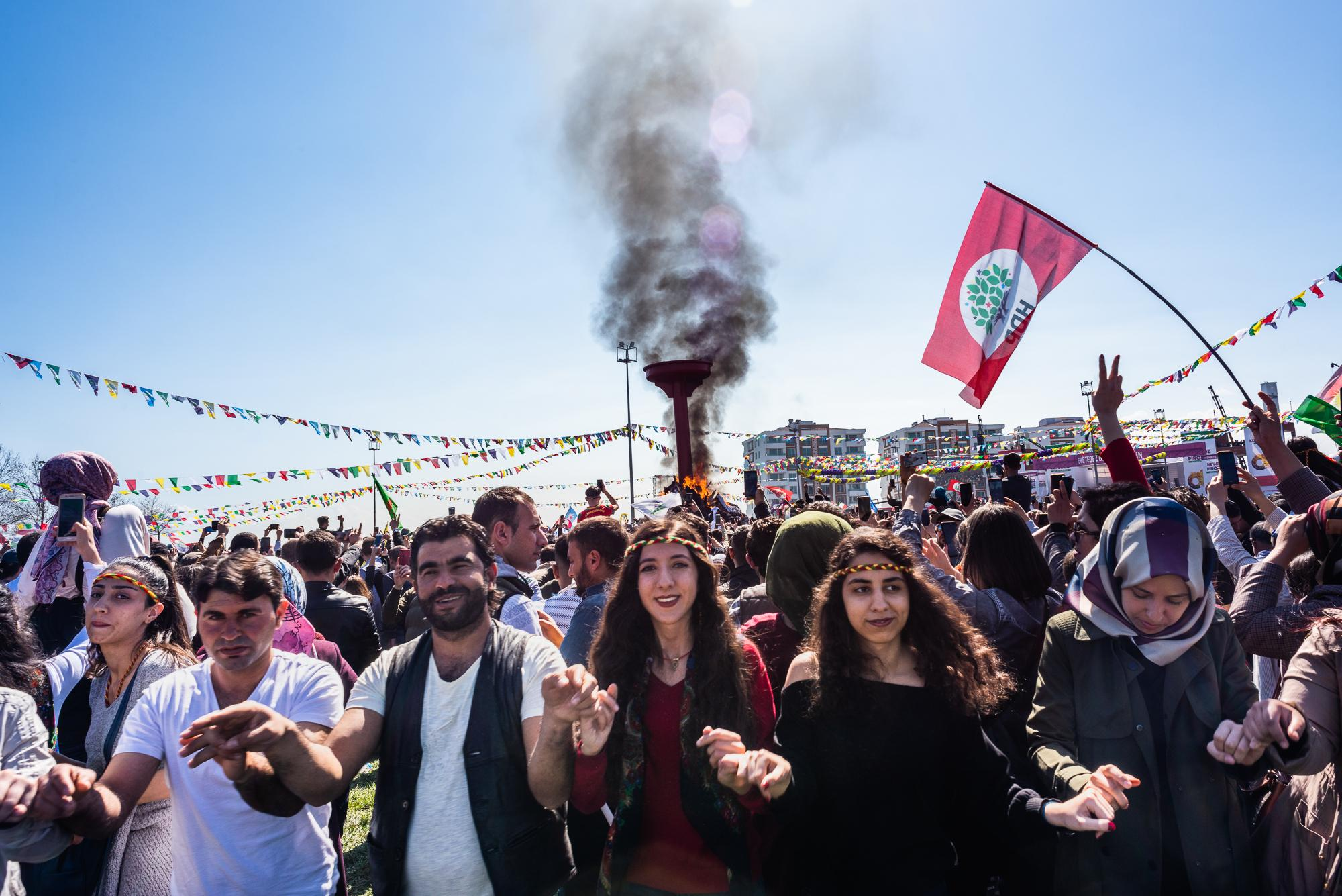 DİYARBAKIR, TURKEY – MARCH 21, 2019: Kurdish people celebrating Newroz, the traditional New Year in Kurdish culture, which usually occurs on 21 March. In Turkey, Newroz is largely considered a symbol of Kurdish identity, as public celebration was banned for decades until 2005. In recent years, the Newroz celebration in Diyarbakır attracts around one million participants and has become a platform for political messages.