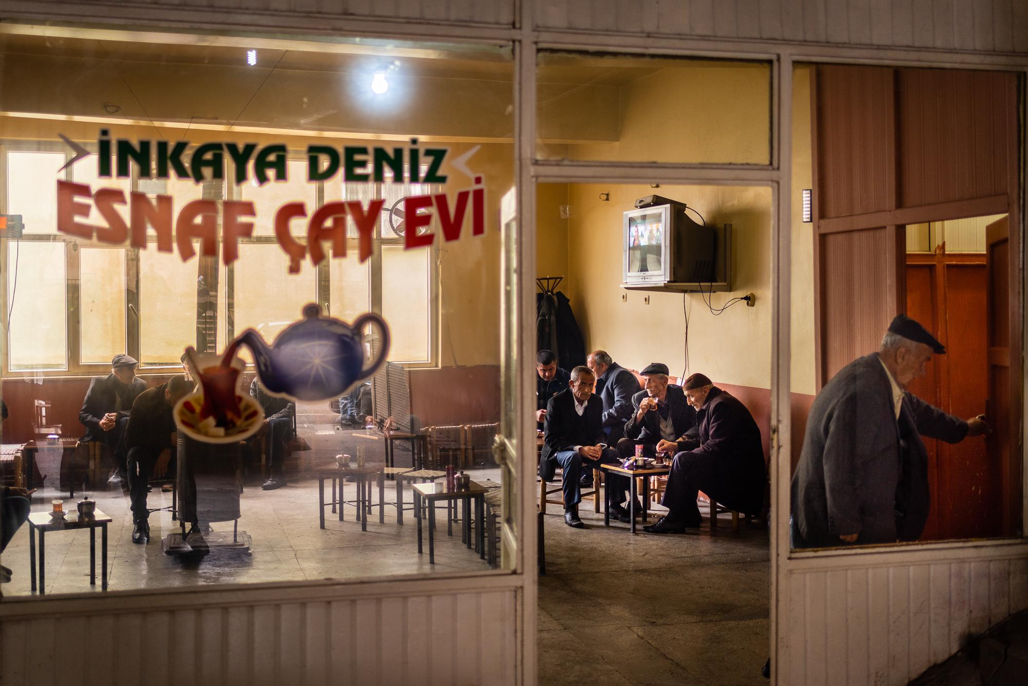 SILVAN, TURKEY – MARCH 28, 2019: Teahouses serve as an important public space for Kurdish men, second only to mosques. Every neighborhood - whether urban or rural - has at least one teahouse, where local people come for a glass of tea, discussing the issues of the day, or playing dominoes with friends.