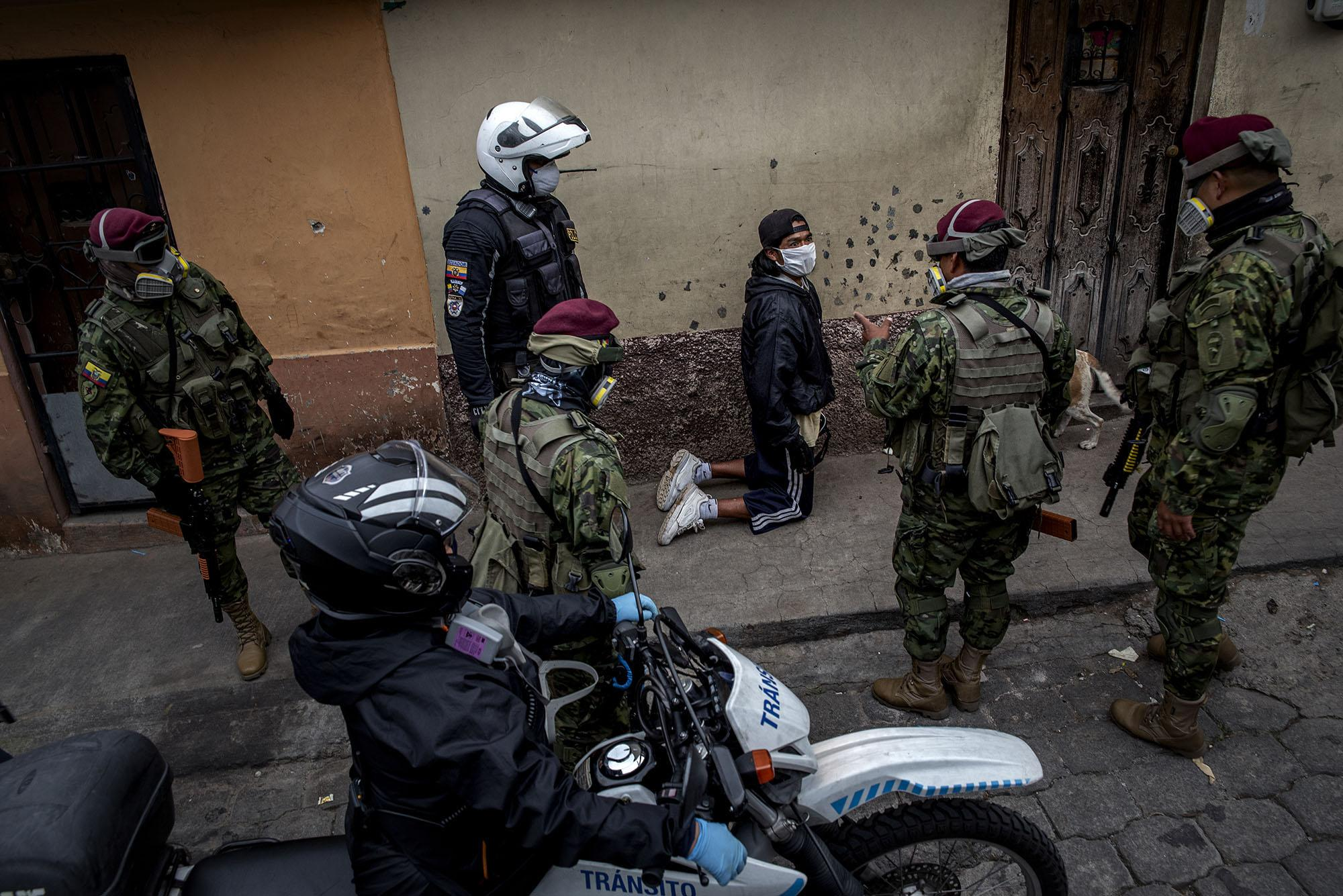 Army and police confiscate a man who violates the curfew in the peripheral neighborhoods of the city on Friday, May 8, 2020 in Quito - Ecuador. Johis Alarcón for The New York Times