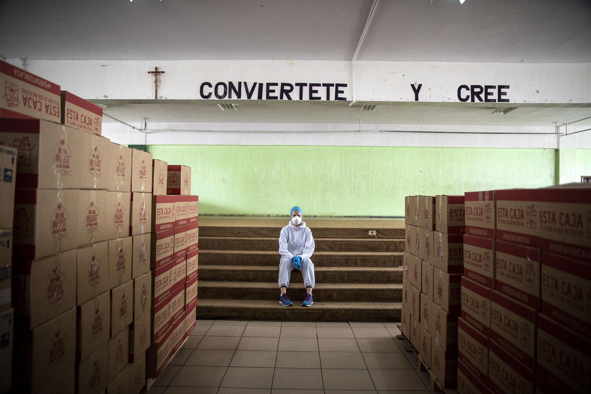 A volunteer organizes the donation baskets for the most affected families on Thursday, Abril 30, 2020 in Quito - Ecuador. Johis Alarcón for The New York Times.