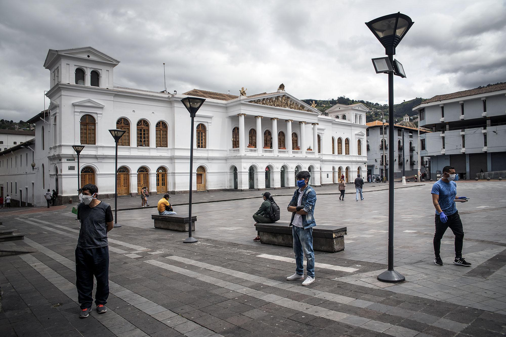"""People keep social distance outside a private clinic in """"Plaza del Teatro"""". Thursday, May 7, 2020 in Quito - Ecuador. Johis Alarcón for The New York Times"""