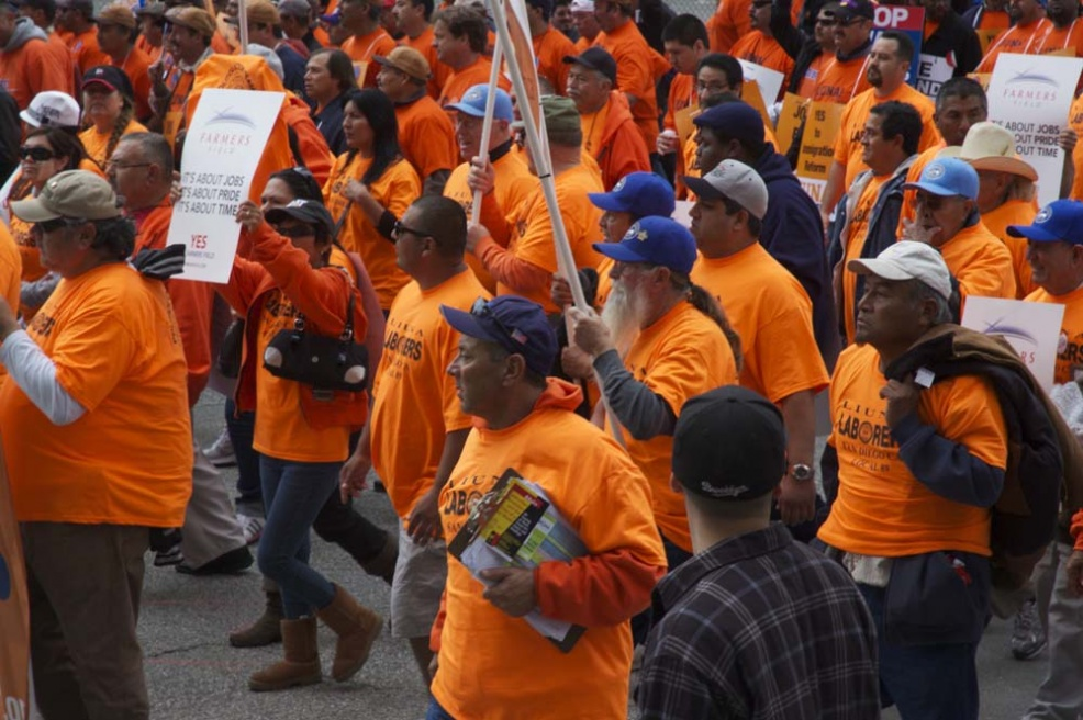 a sea of orange SEIU workers protesting in solidarity for Wisconsin
