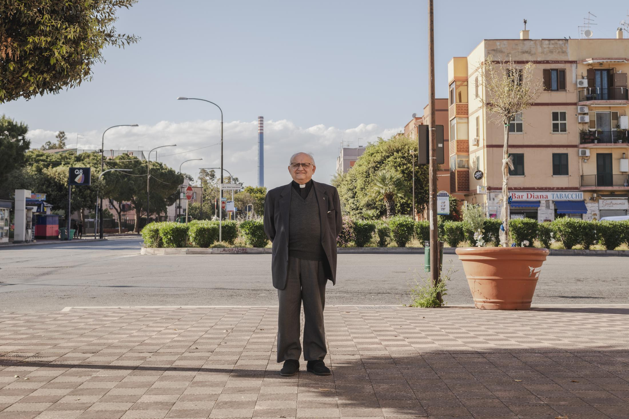 """– Father Nicola Preziuso (71). Father Nicola Preziuso is a pastor in the Tamburi district and has also been spiritually following for 40 years the workers of the former Ilva company, inside the factory. """"I am not a chaplain, anyway. It is a service that I give for free together with my congregation: that of the Josephites of Murialdo, whose mission is precisely about the vocation to work"""". About how the district lived the contagion, he says: """"I had to fight to overcome clericalism because many said that it was God who sent the Coronavirus. I constantly remembered that the Lord gave us two lungs: one is faith; the other is the reason. People must use both"""". For two months, in the house next to the parsonage, the Josephites hosted in self-isolation three nurses who worked in the COVID hub of Taranto and were afraid of going back home and infect their families."""