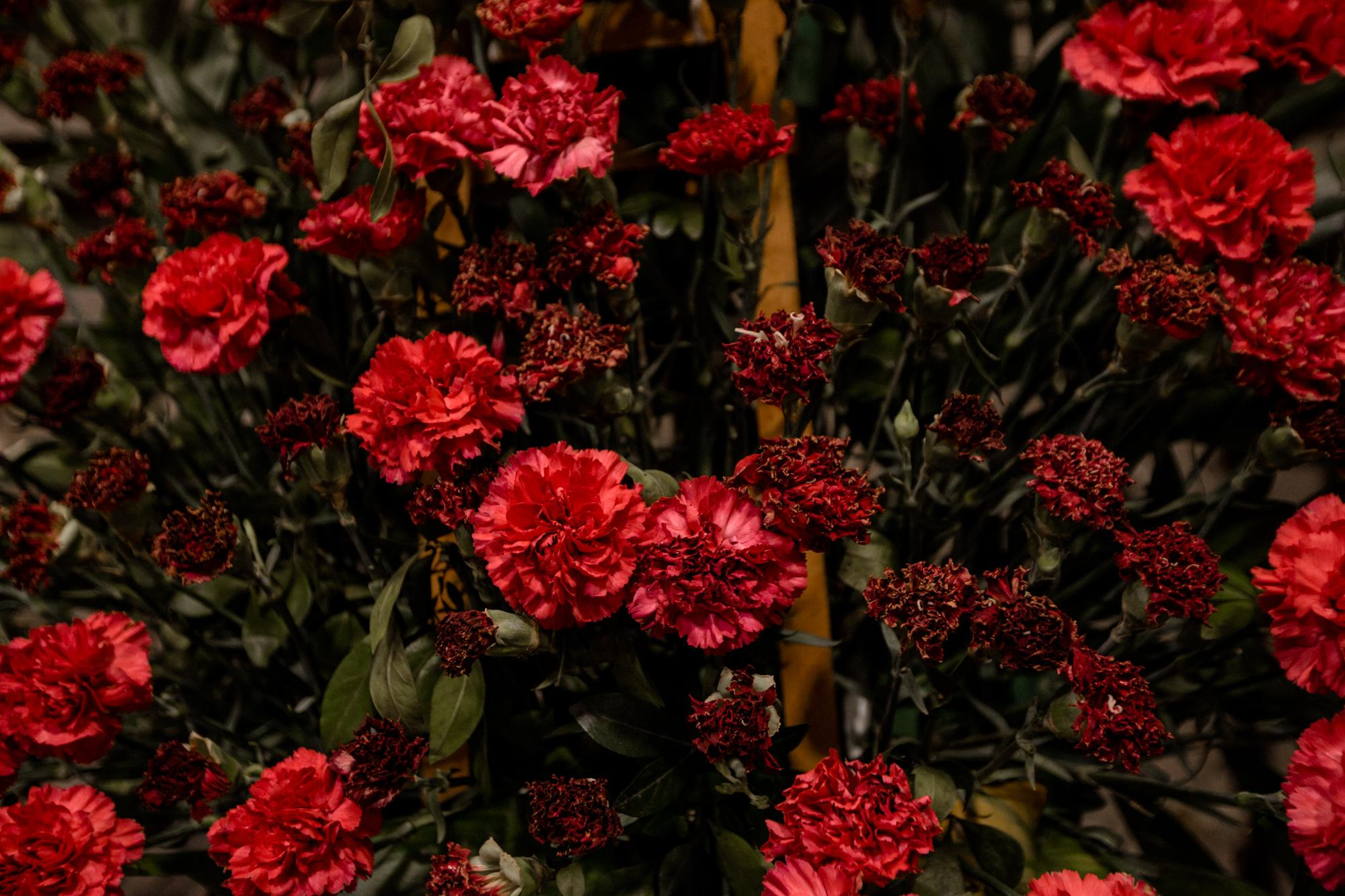 Red carnations are always the chosen flower for the Nazarenes to decorate the image of Jesus.