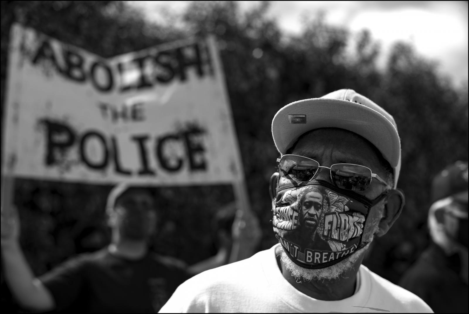 Elderly protestor, face covered with George Floyd mask, Cochran Baptist Church in Mid-Wilshire area of Los Angeles, 06/06/2020.