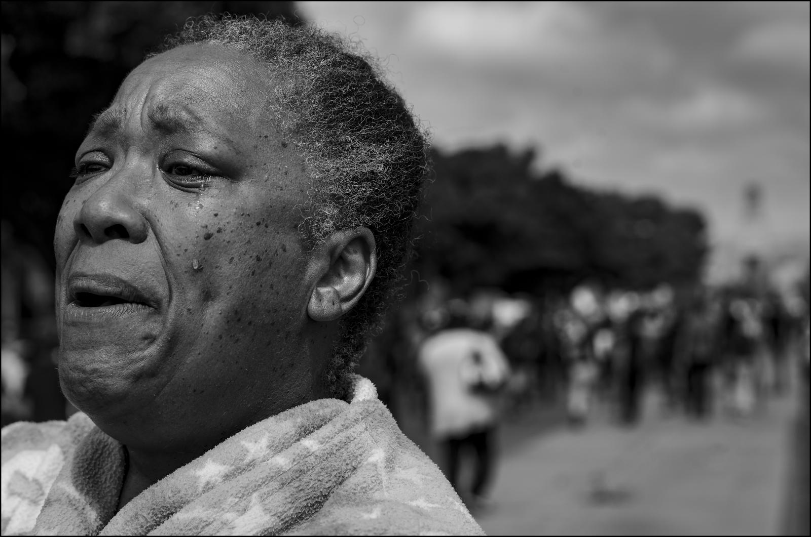 Teresa A. Pitts breaks into tears as a Anti-Police violence march passes her home on San Vicente Blvd & Carmona in Mid-Wilshire area of Los Angeles, CA 06/06/2020